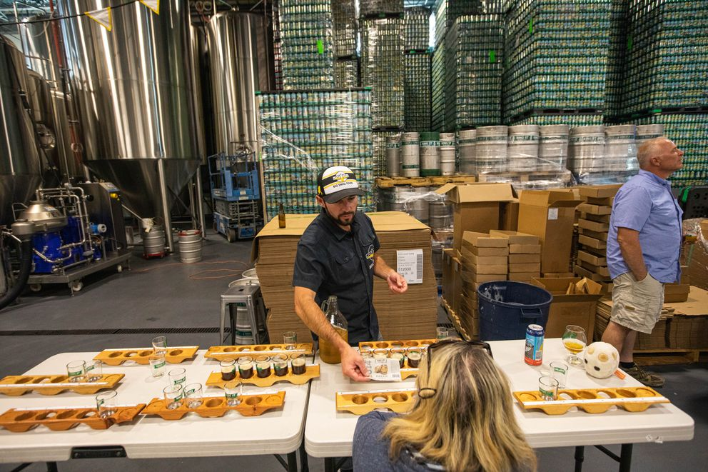 Big Swig Tours owner Bryan Caenepeel pours samples of beer during a tour of the King Street brewery Thursday, Aug. 29, 2019. Proposed state regulations would not allow tours like this. (Loren Holmes / ADN)