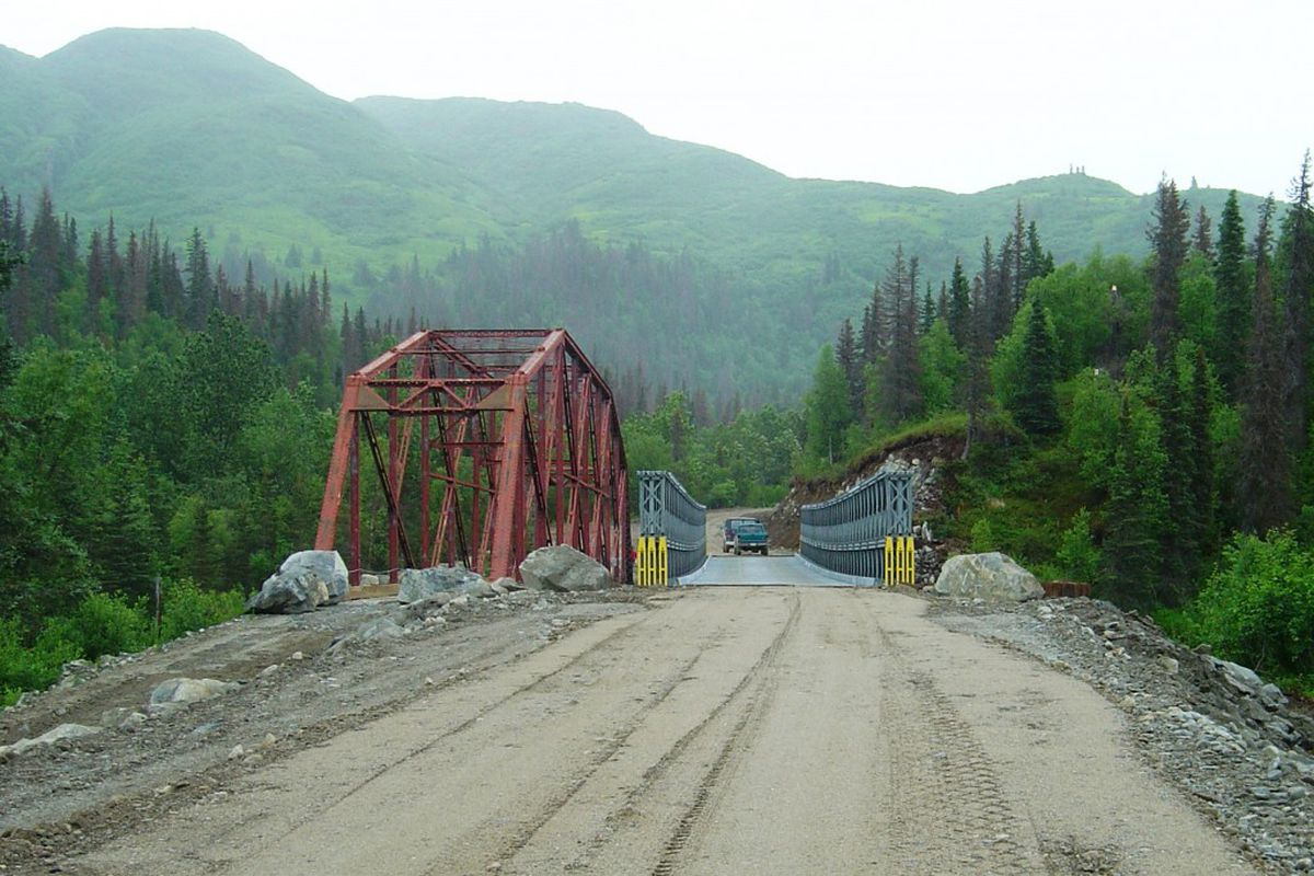 The historic 1930s bridge, left, stands next to a temporary bridge constructed in 2003 over the Iliamna River. (Alaska Department of Transportation and Public Facilities)