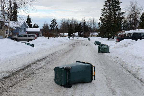 A trashcan rests in the middle of a side street in Eagle River, Alaska, on Thursday, Jan. 26, 2017. Warm weather, wind and rain brought dangerous driving conditions to southcentral roads. (Bob Hallinen / Alaska Dispatch News)