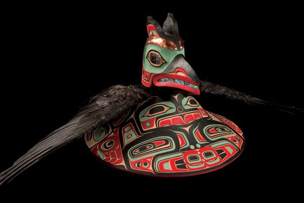A raven hat made by Tlingit carver Archie Cavanaugh. Cavanaugh found himself in hot water for using raven feathers in the headdress and flicker feathers in a hat. The U.S. Fish and Wildlife Service said he had violated the Migratory Bird Treaty Act in using the feathers in his artwork. (Photo courtesy Sealaska Heritage Institute)