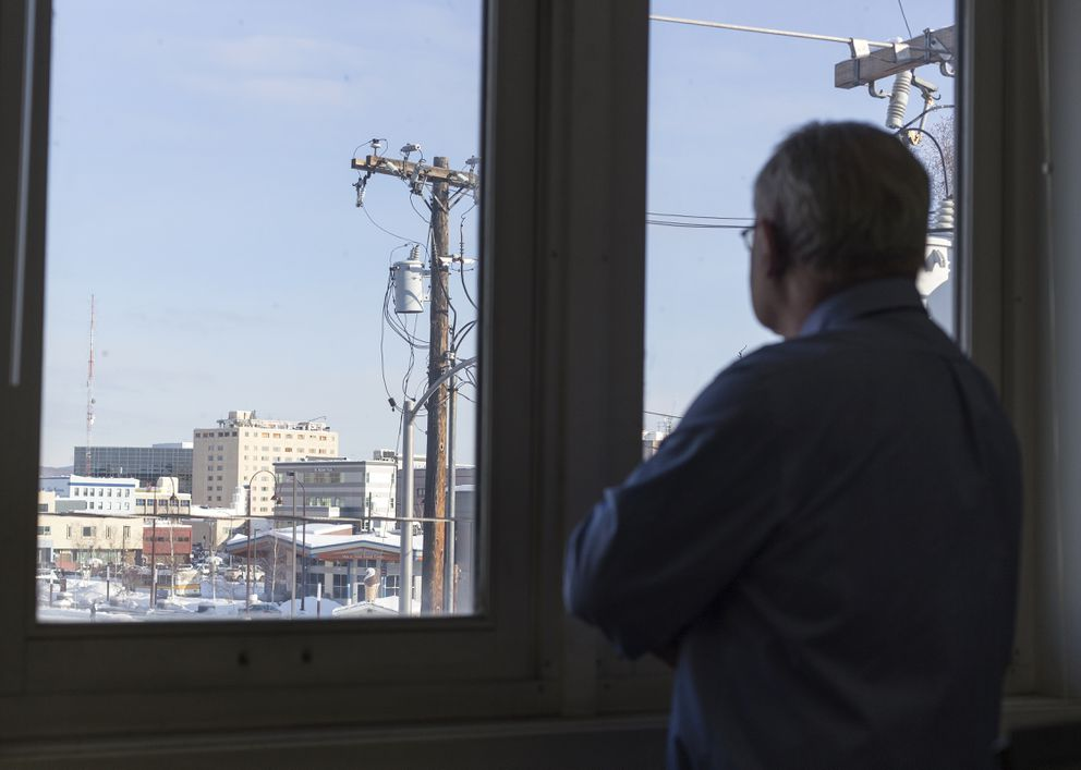 Pat Smith looks outside his office window at the Polaris Building in downtown Fairbanks. (Rugile Kaladyte / Alaska Dispatch News)