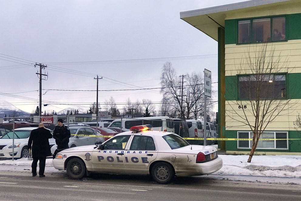 APD Officers at the scene of a homicide investigation at 618 E. 9th Avenue on Sunday, Dec. 10, 2017. This is the city's 34th homicide, matching 2016 for the most homicides in one year. (Julia O'Malley / ADN)