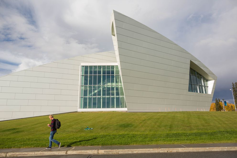 A pedestrian walks by the Museum of the North on the campus of the University of Alaska Fairbanks on September 9, 2015. (Loren Holmes / ADN archive)