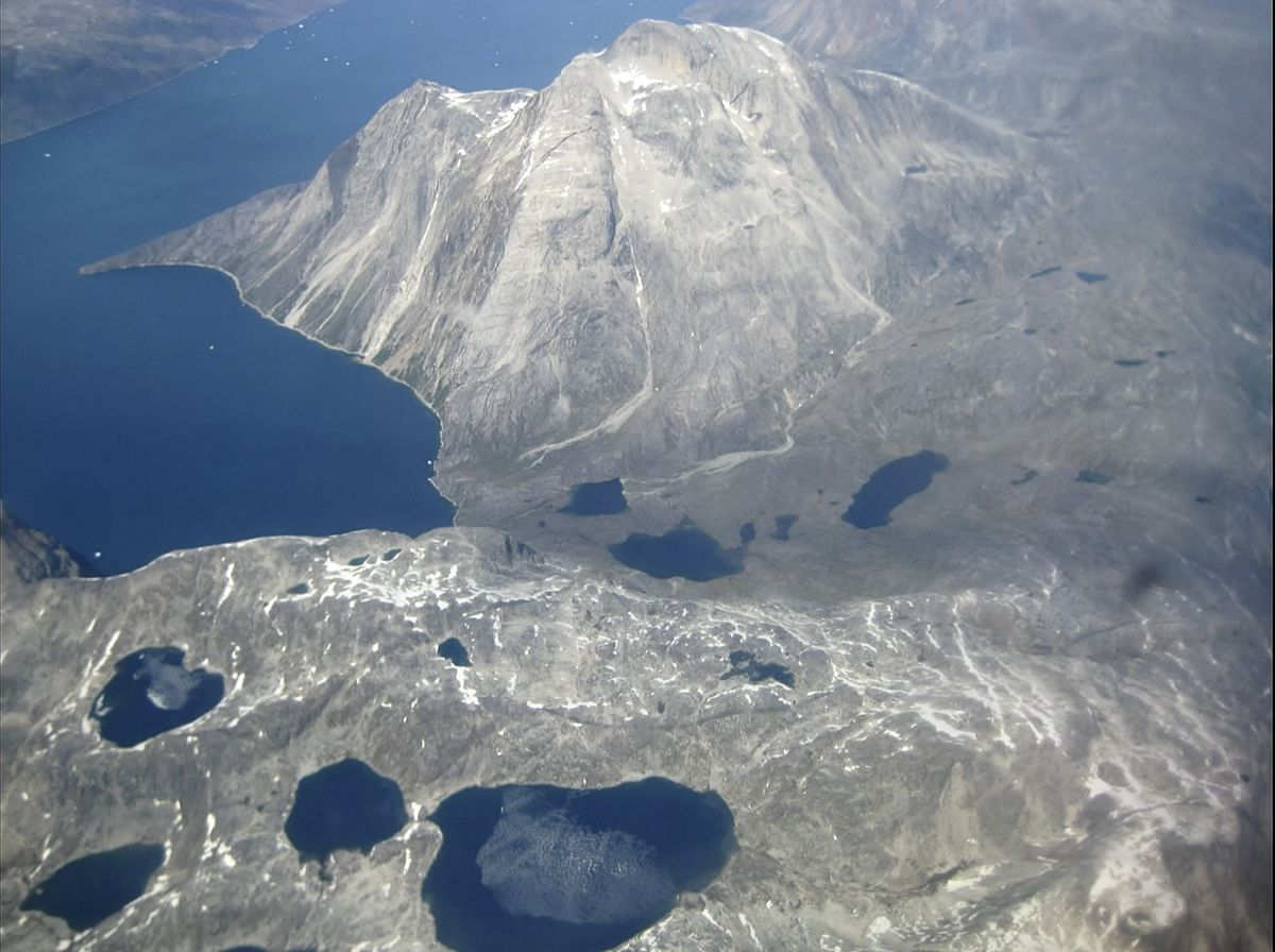 In this image taken on June 22, 2019 an aerial view of melt water lakes on the edge of an ice cap in Nunatarssuk, Greenland. Milder weather than normal since the start of summer, led to the UN's weather agency voicing concern that the hot air which produced the recent extreme heat wave in Europe could be headed toward Greenland where it could contribute to increased melting of ice. (AP Photo/Keith Virgo)