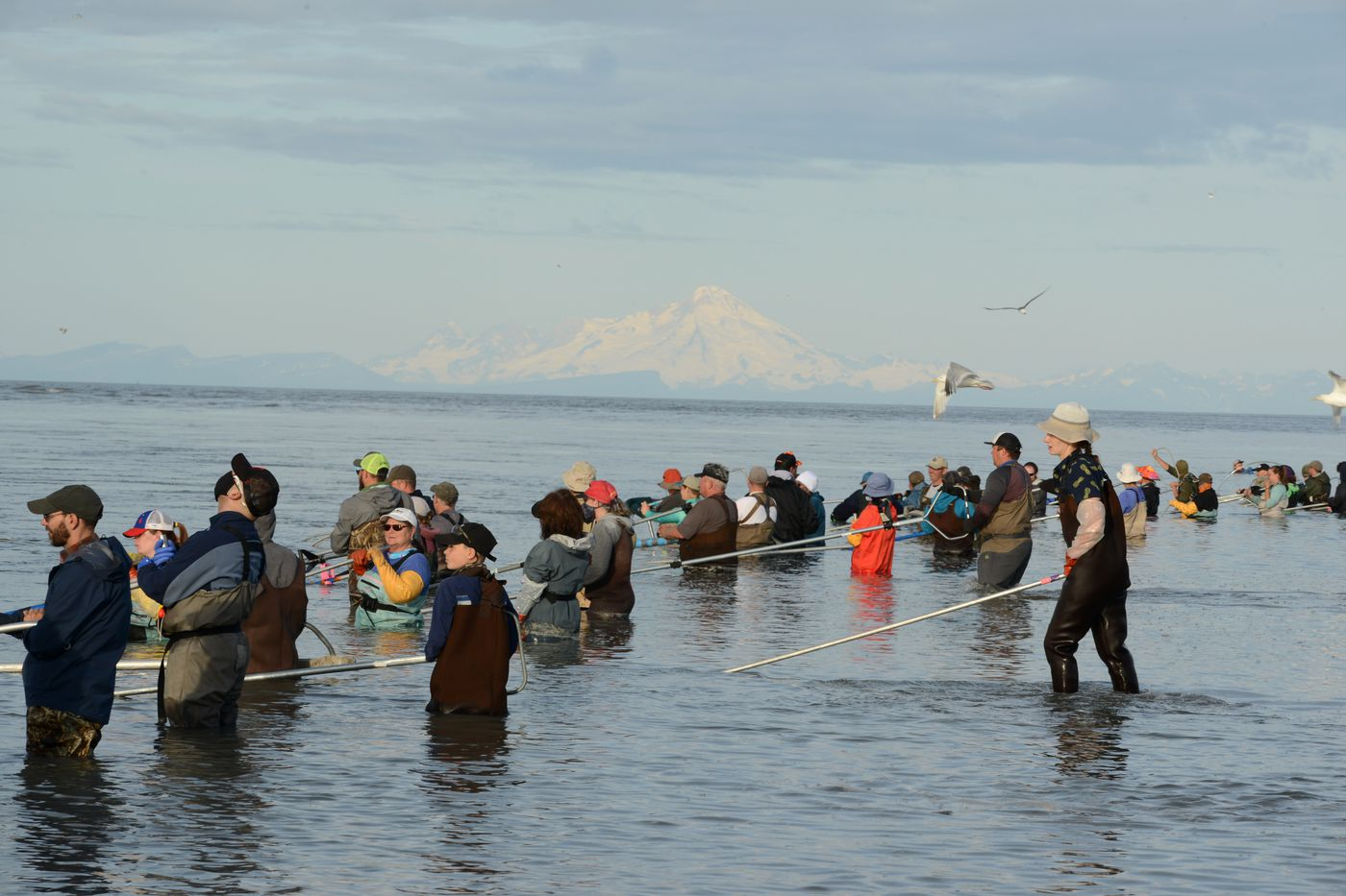 A few masks were present among the dipnetters on the Kenai River beach July 21, 2020. The fishing was slow. (Anne Raup / ADN)