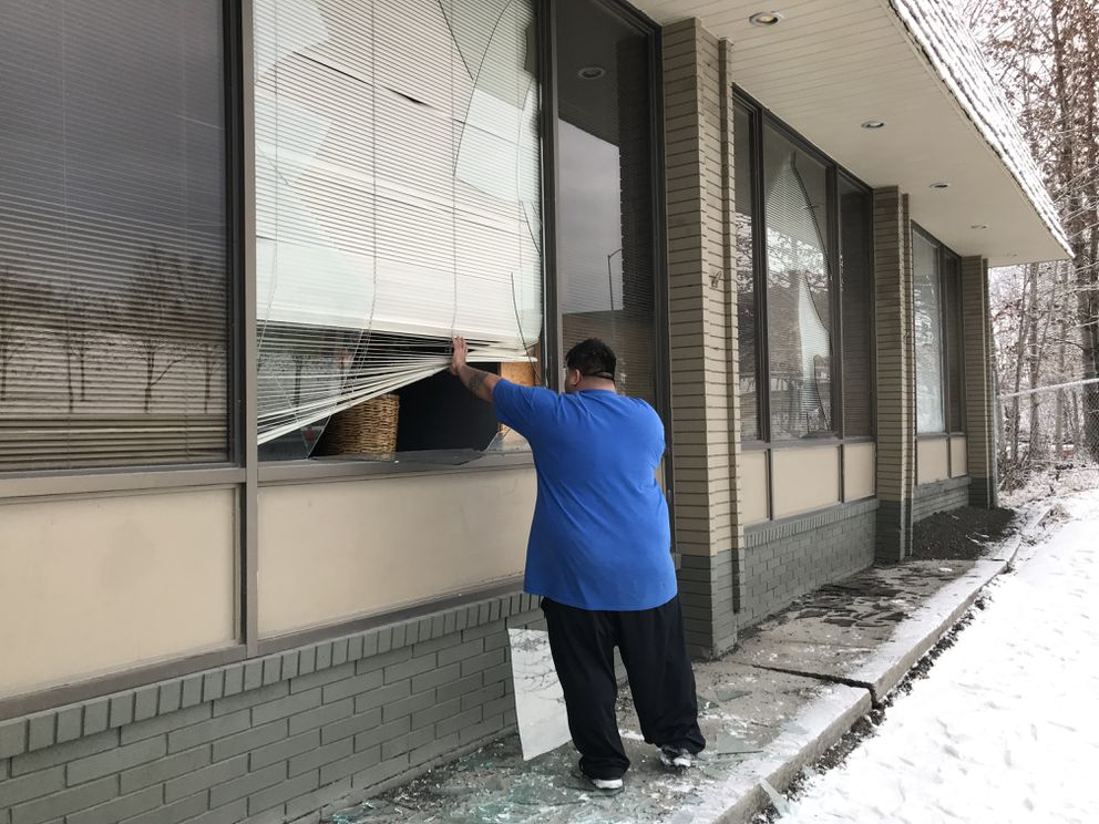 Junior Patea checked on the Jesus Is Lord Church at East Third Avenue and Post Road in Anchorage after the earthquake on Nov. 30, 2018, which broke windows, caused structural damage to the walls and foundation, along with broken water pipes. (Bill Roth / ADN)