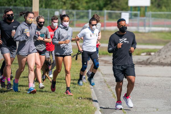 DeWayne Ingram leads a group of runners to the finish of a 1.5-mile run on Saturday, June 27, 2020 at Service High School in Anchorage. Ingram, a Black man, was stopped on a nearby street during a run a week ago by a white woman in a SUV who asked if he belonged in the neighborhood. During the run people from the neighborhood held sings of support and cheered him on.