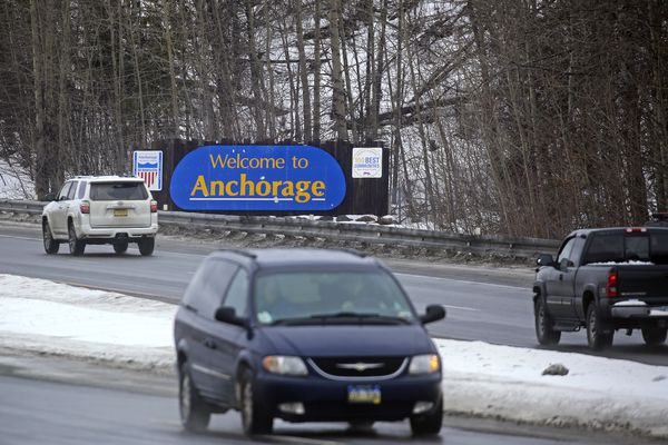 Vehicles drive north and southbound along the Seward Highway in Anchorage on Friday, Feb. 26, 2021. (Emily Mesner / ADN)