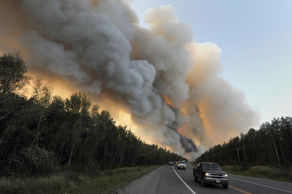 Motorists head south after turning around on the Parks Highway as strong winds advanced the wildfire on Sunday, Aug. 18, 2019. (Bill Roth / ADN)