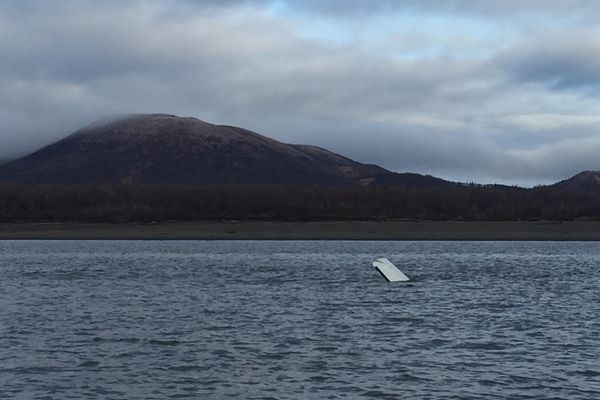 Part of Kyle Stevens' plane is seen sticking out of the Yukon River. (Photo courtesy of Alaska State Troopers)