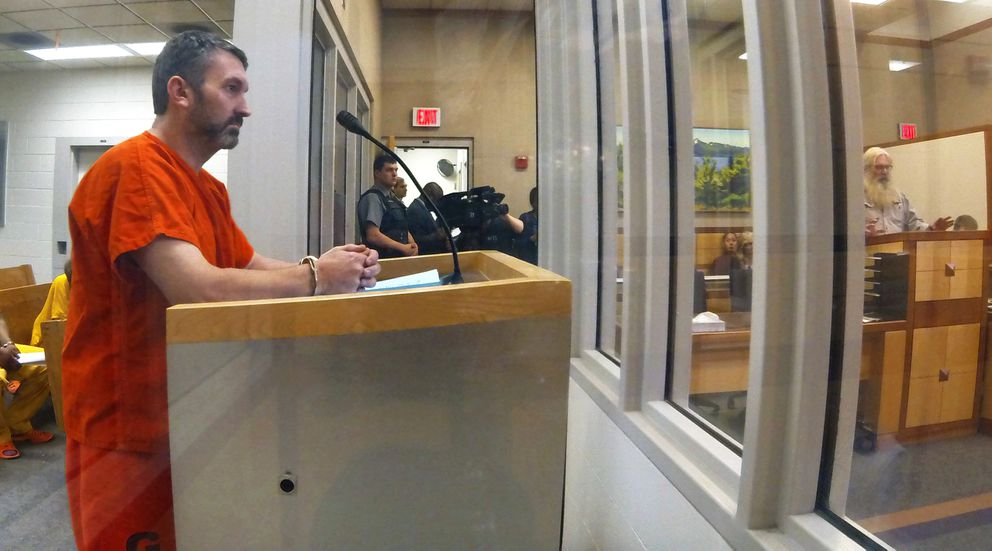 Anthony Pisano, left, listens as Rich McCreadie, right, addresses the court regarding his slain son Daniel McCreadie during Pisano's appearance in the Anchorage jail court on Wednesday. (Erik Hill / Alaska Dispatch News)