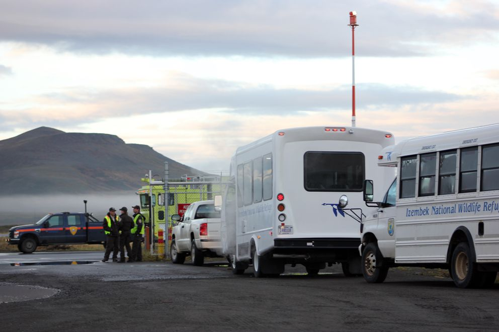 Buses queue up at the airport after an American Airlines jet makes an unplanned landing in Cold Bay on Wednesday morning, Oct. 12, 2016, in Southwest Alaska. (Candace Schaack)
