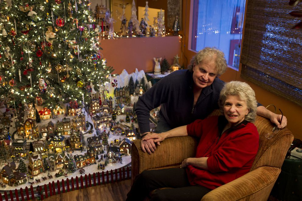 Frank and Jeanne McQueary display their model Christmas village beneath their Christmas tree. Photographed on Friday. (Marc Lester / ADN)