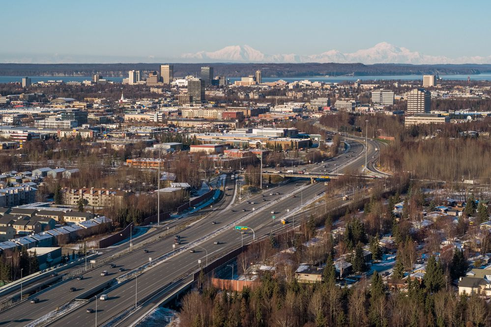 Denali and Foraker are visible behind downtown Anchorage on Thursday, Nov. 1, 2018, in an aerial view from south Anchorage. (Loren Holmes / ADN)