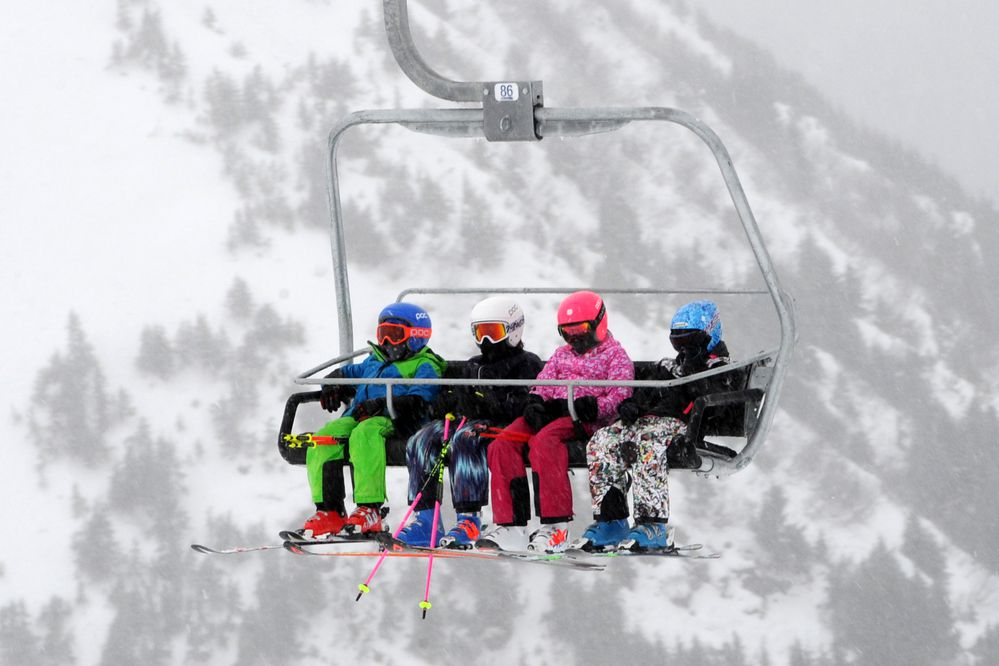 Skiers ride the Glacier Bowl Express chairlift during a snowstorm at Alyeska Resort on Sunday, Dec. 10, 2017. The ski resort in Girdwood opened for the season, from top to bottom, on Saturday and is operating seven days a week. (Bill Roth / ADN)