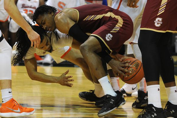 Josh Delaney, of Sam Houston State, and Cameron Johnson, of College of Charleston, battle for the ball in the 2017 Great Alaska Shootout at the Alaska Airlines Center in Anchorage, Alaska on Thursday, Nov. 23, 2017. (Bob Hallinen / ADN)