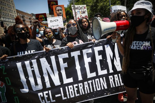 Protesters chant as they march after a Juneteenth rally at the Brooklyn Museum, Friday, June 19, 2020, in the Brooklyn borough of New York. Juneteenth commemorates when the last enslaved African Americans learned they were free 155 years ago. Now, with support growing for the racial justice movement, 2020 may be remembered as the year the holiday reached a new level of recognition. (AP Photo/John Minchillo)