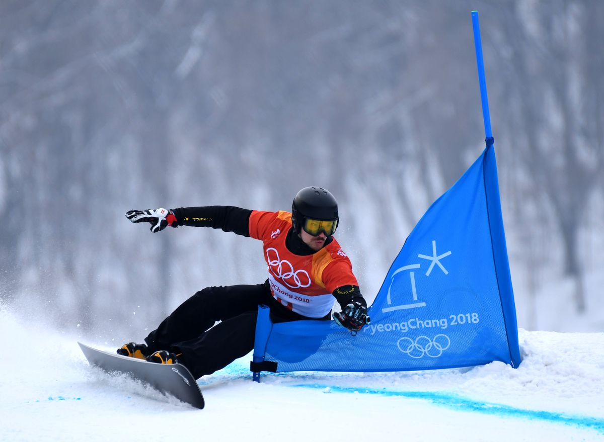 Feb 24, 2018; Pyeongchang, South Korea; Vic Wild (OAR) competes in the snowboard parallel giant slalom event during the Pyeongchang 2018 Olympic Winter Games at Phoenix Snow Park. (Jack Gruber / USA TODAY Sports)