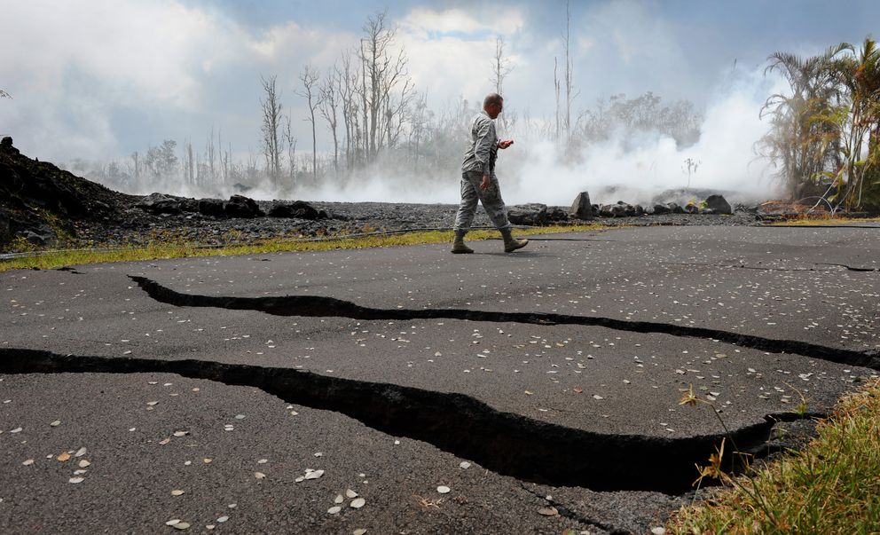 National Guard Col. Charles Anthony takes readings of sulfur dioxide gas May 18 near a fissure on Kupono Road in Pahoa, Hawaii. The Kilauea volcano, on the Big Island, has been increasingly active. (Photo for The Washington Post by Linda Davidson)