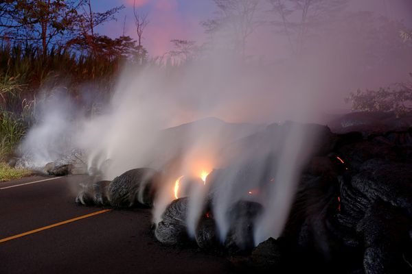 Volcanic gases rise from the Kilauea lava flow that crossed Pohoiki Road near Highway 132, near Pahoa, Hawaii, U.S., May 28, 2018. REUTERS/Marco Garcia