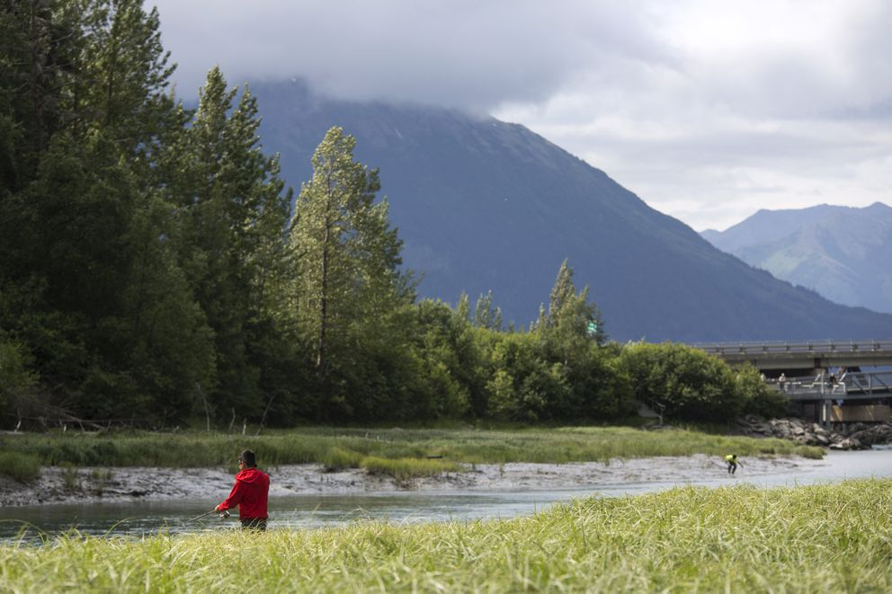 Anglers try their luck at Bird Creek on opening day. (Rugile Kaladyte / Alaska Dispatch News)