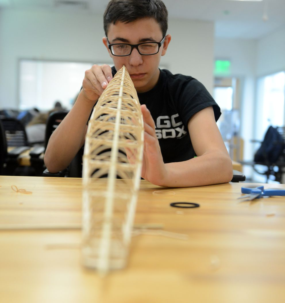 Nome sophomore Reese Bahnke eyeballs the keel on a model kayak he is building in Anchorage on Wednesday, Aug 1, 2018. Bahnke is taking part in a 5-week mathematics program in the Alaska Native Science and Engineering Program at UAA. (Bob Hallinen / ADN)