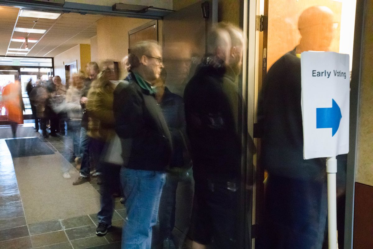 Voters file into the state elections office in Midtown Anchorage for early voting on Thursday. (Loren Holmes / Alaska Dispatch News)