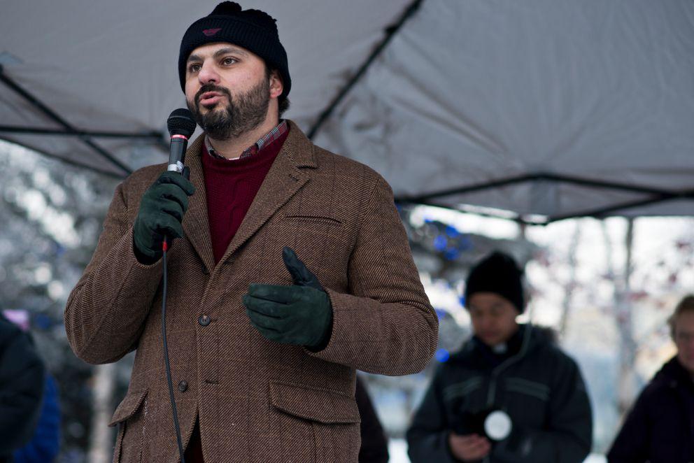 Dr. Youssef Barbour speaks to the participants at the vigil. (Marc Lester / Alaska Dispatch News)