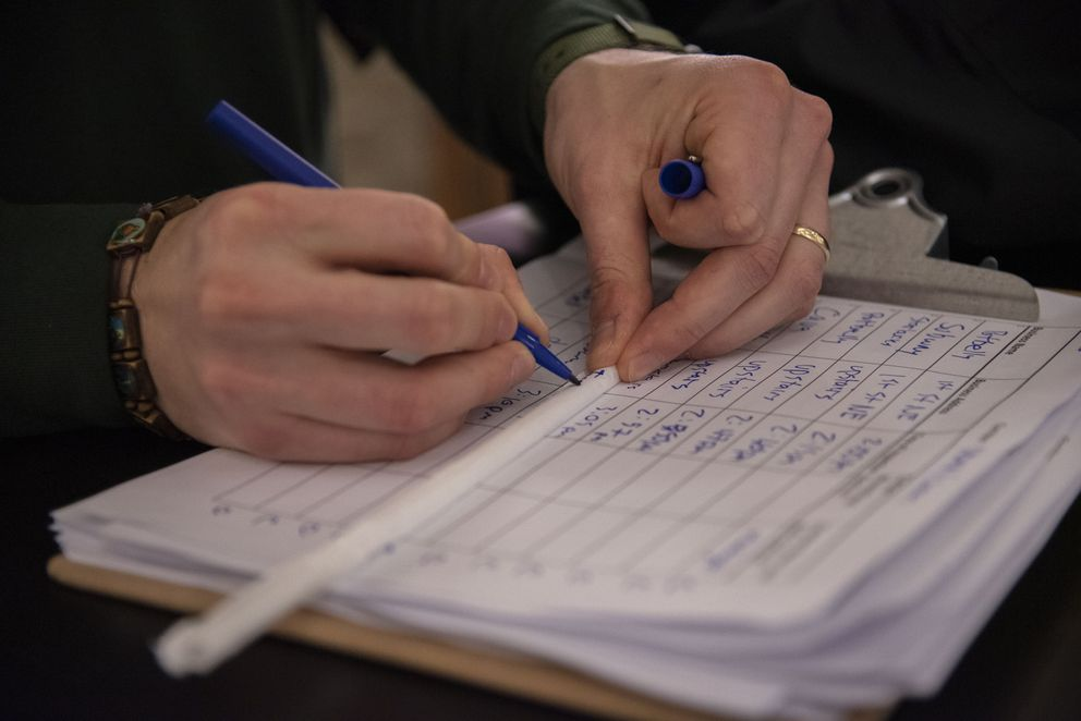 Zach Rybarczyk, who works for D.C.'s Department of Energy and Environment, writes the name of a Union Station restaurant on the paper sleeve of a plastic straw. Washington Post photo by Calla Kessler