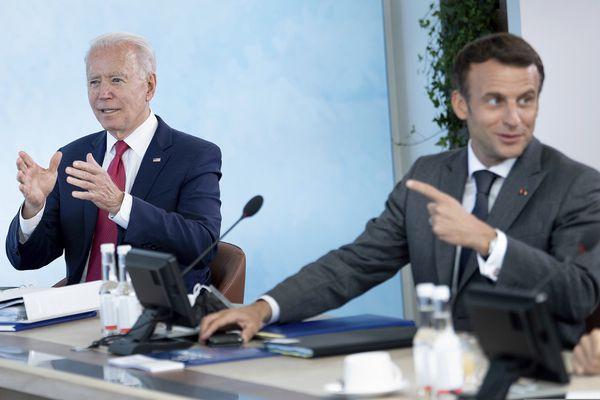 US President Joe Biden, left, listens as France's President Emmanuel Macron speaks during a working session at the G7 summit in Carbis Bay, Cornwall, England, Saturday, June 12, 2021. (Brendan Smialowski/Pool Photo via AP)