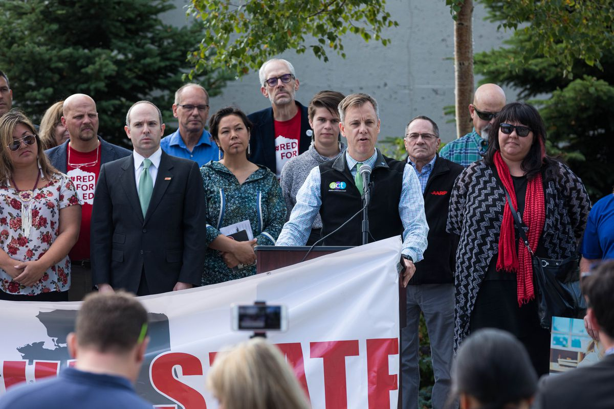 Trevor Storrs, president and CEO of Alaska Children's Trust, speaks at a Save Our State rally Wednesday, Aug. 7, 2019 outside the Atwood Building in Anchorage. Save Our State a coalition of groups advocating for the passage of a state operating budget without additional cuts. (Loren Holmes / ADN)