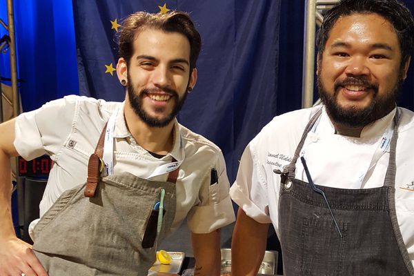 Chef Lionel Uddipa (right) and sous chef Jacob Pickard at the Great American Seafood Cook-Off Saturday, Aug. 5, 2017 in New Orleans. Uddipa won the competition with a dish of alder-smoked king crab risotto with sea asparagus and Alaska salmon caviar. (Jeremy Woodrow / ASMI)