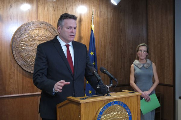 Alaska Gov. Mike Dunleavy speaks to reporters as his administration rolls out his budget plan in Juneau, Alaska, Wednesday, Feb. 13, 2019. Gov. Dunleavy's budget proposal includes deep cuts to public education, the university system, Medicaid and Alaska's ferry system. The budget plan also eliminates state support for public broadcasting and proposes changes in petroleum property tax collections that will benefit the state but affect areas like the North Slope Borough. The director of Dunleavy's budget office, Donna Arduin, is pictured on right. (AP Photo/Becky Bohrer)