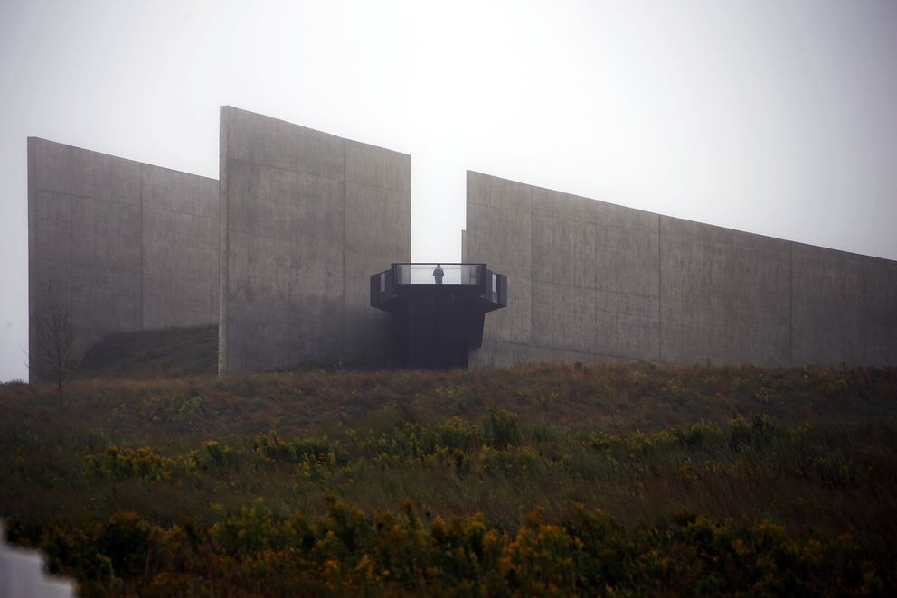 FILE - In this Monday, Sept. 10, 2018 file photo, a visitor to the Flight 93 National Memorial in Shanksville, Pa., stands on a platform overlooking the monument, as the nation marks the 17th anniversary of the Sept. 11, 2001 attacks. (AP Photo/Gene J. Puskar)
