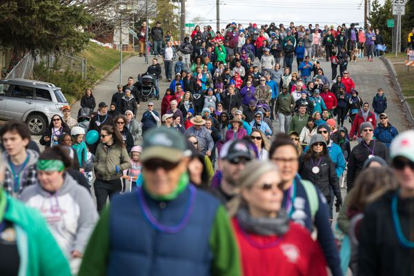 Participants in the Out of Darkness Community Walk make their way down N Street Saturday, May 12, 2018 at Delaney Park. Organizers with the American Foundation for Suicide Prevention said hundreds of people participated in the 8th annual walk. (Loren Holmes / ADN)