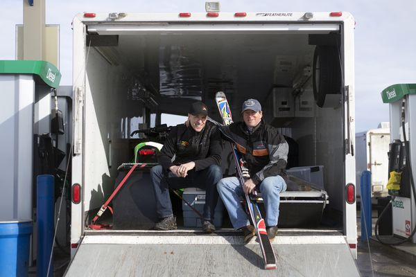 Snowmachine driver Len Story and skier Eric Heil sit in a trailer before leaving for Arctic Man on Sunday, April 2, 2017, in Anchorage. Story and Heil have been teammates and competing in Arctic Man since 1990.