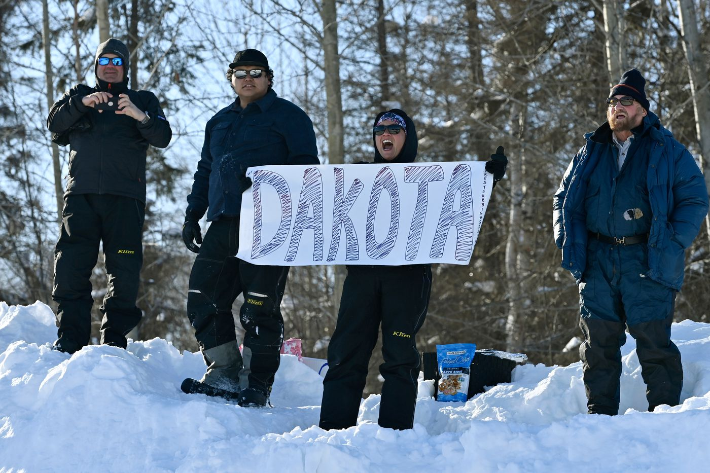 Supporters for Willow rookie Dakota Schlosser cheer from afar as he enters the starting chute. (Marc Lester / ADN)