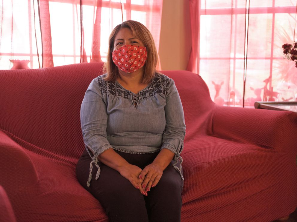 Raquel Chavez lost her father, Ángel Chavez, and a brother, Juan Francisco Chavez, to the coronavirus. Other relatives have fallen ill, too. Photo by Brenda Bazán for The Washington Post