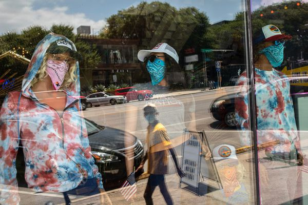 Mask-wearing mannequins at a store in Austin's South Congress neighborhood. Texas is among the states that have rolled back their reopenings amid a spike in coronavirus cases. Florida also reversed course on loosened restrictions after Gov. Ron DeSantis, a Republican, pushed for a quick recovery. (Photo by Tamir Kalifa for The Washington Post)