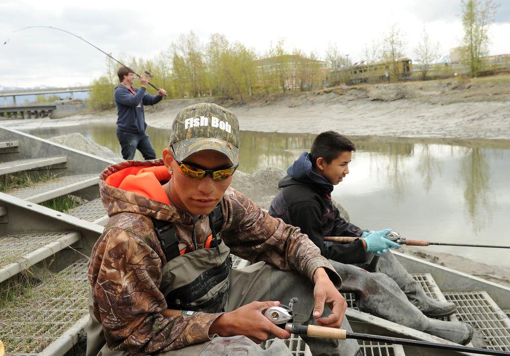 Robert Rozelle fishes Ship Creek on Wednesday with Shawn Sanford. (Bob Hallinen / Alaska Dispatch News)