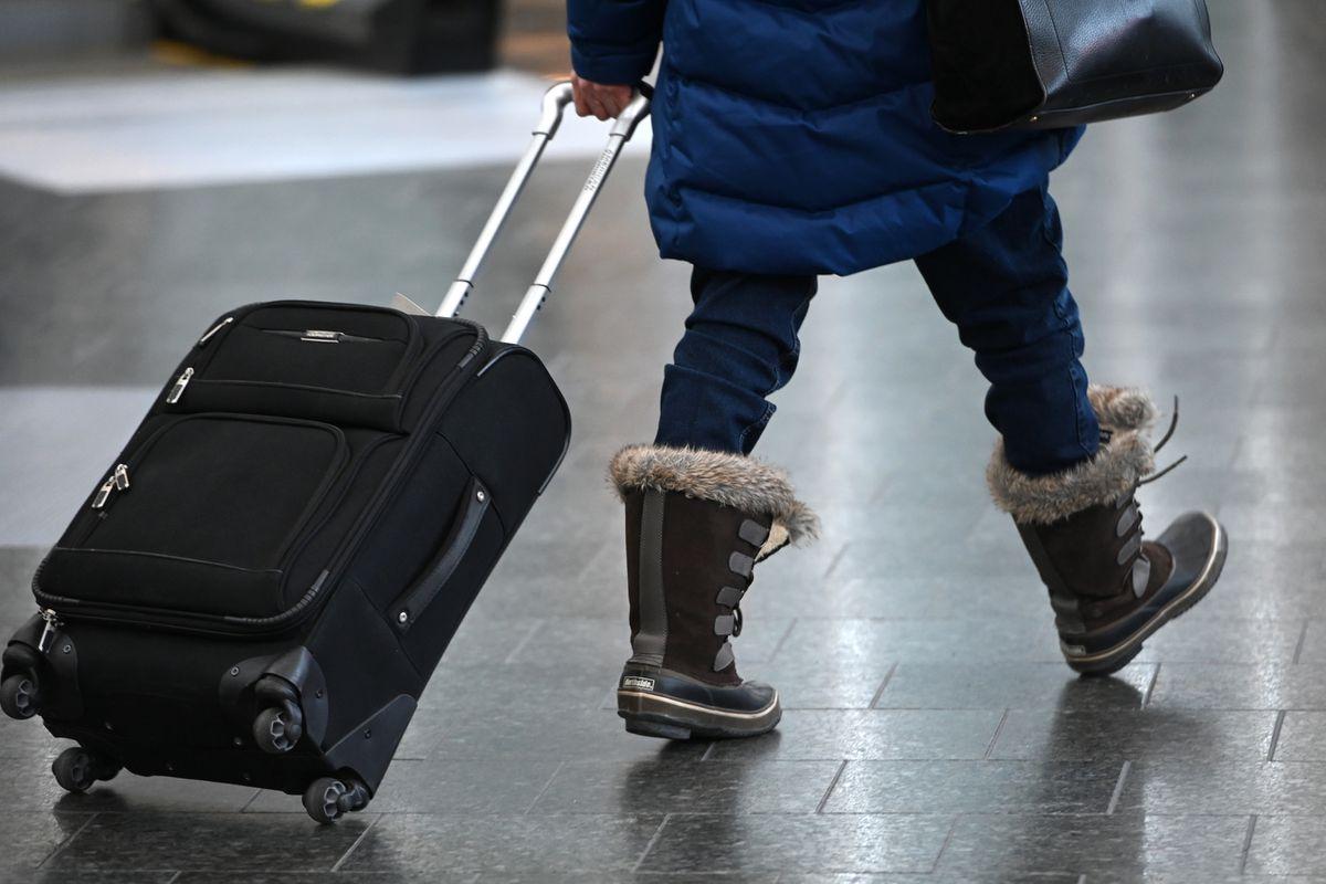 An air traveler walks through Ted Stevens Anchorage International Airport on Thursday, Nov. 19, 2020. (Bill Roth / ADN)
