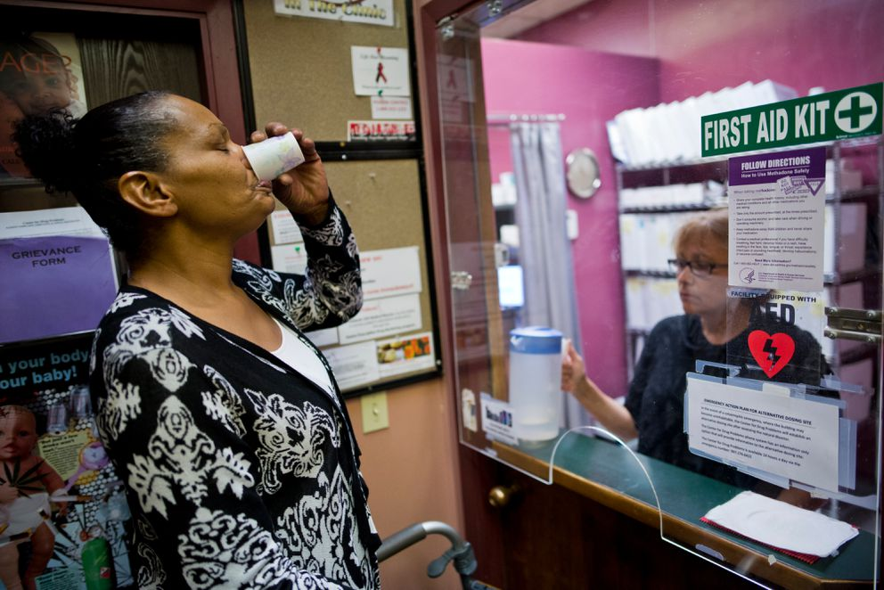 Stephanie Williams takes methadone at the Center for Drug Problems on Wednesday, Aug. 17, 2016. Williams says the treatment helps her maintain family relationships and hold a job. (Marc Lester / Alaska Dispatch News)