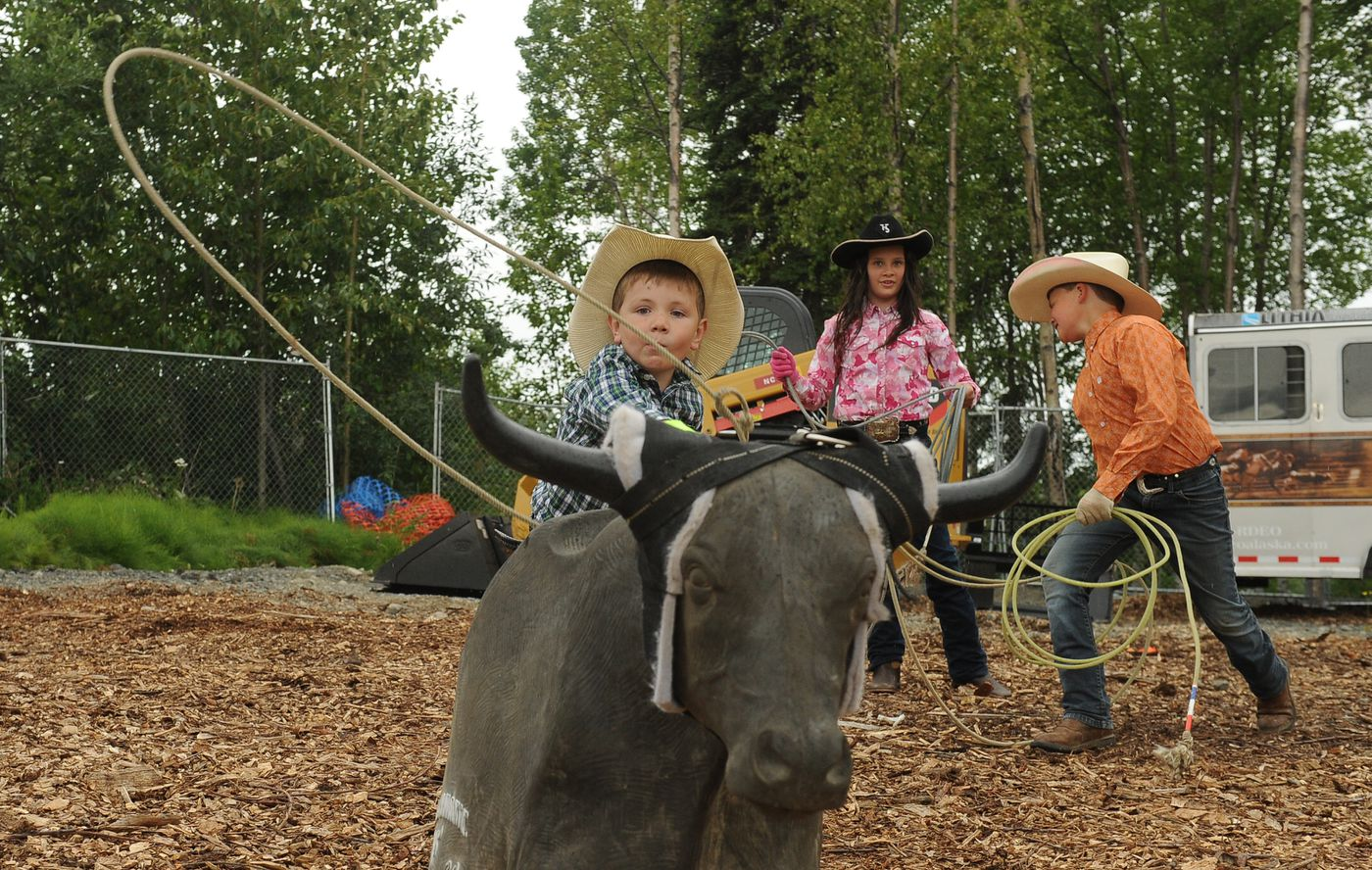 Youngsters compete in the Alaska Rodeo's Junior Rodeo during the Bear Paw Festival in Eagle River, AK on Friday, July 13, 2018. (Bob Hallinen / ADN)