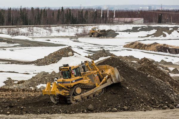 Exhaust stacks on the JBER Landfill Gas Waste to Energy Plant are seen beyond the Anchorage Municipal Landfill on Aril 30, 2013. The plant burns methane from the landfill, supplying about half of Ft. Richardson's energy needs. (Loren Holmes / Alaska Dispatch News)