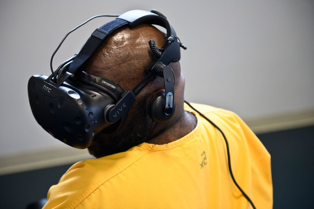 Lamont Moore tries a meditative scenario during a virtual reality demonstration. Prisoners at Spring Creek Correctional Center in Seward tried a few virtual reality scenarios on May 11, 2018. The Alaska Department of Corrections is exploring whether virtual reality can play a role in reforming prisoners and preparing them for release. (Marc Lester / ADN)