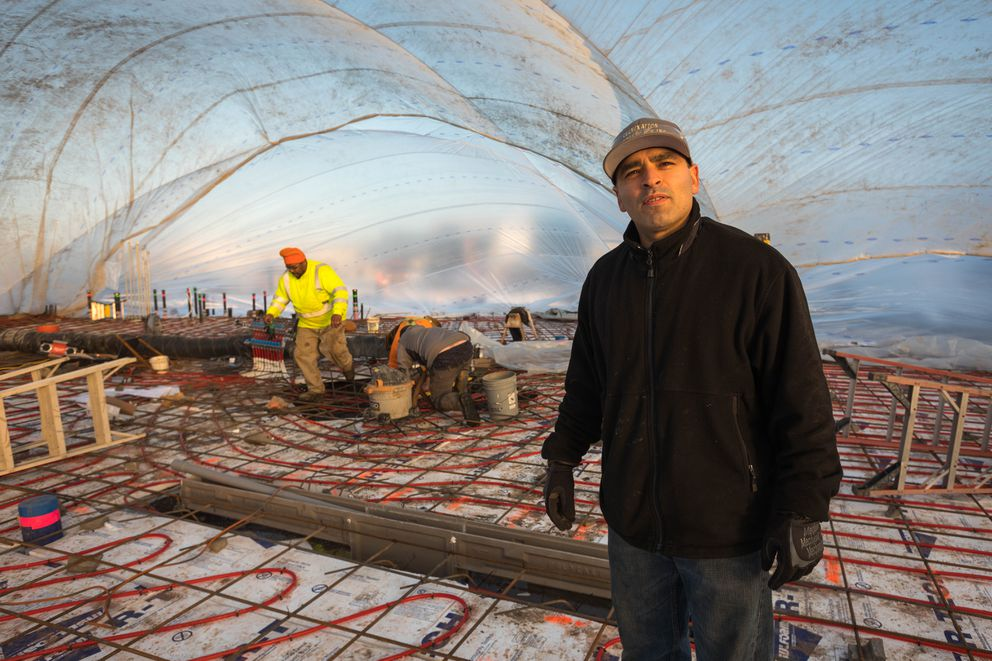 Ralfy Quepons, owner of Culmination Motorsports, on the site of his new building in south Anchorage Wednesday. Quepons building will house not only his garage, but also a new Fire Island bakery location and cycle studio Vib Cycle.  (Loren Holmes / Alaska Dispatch News)