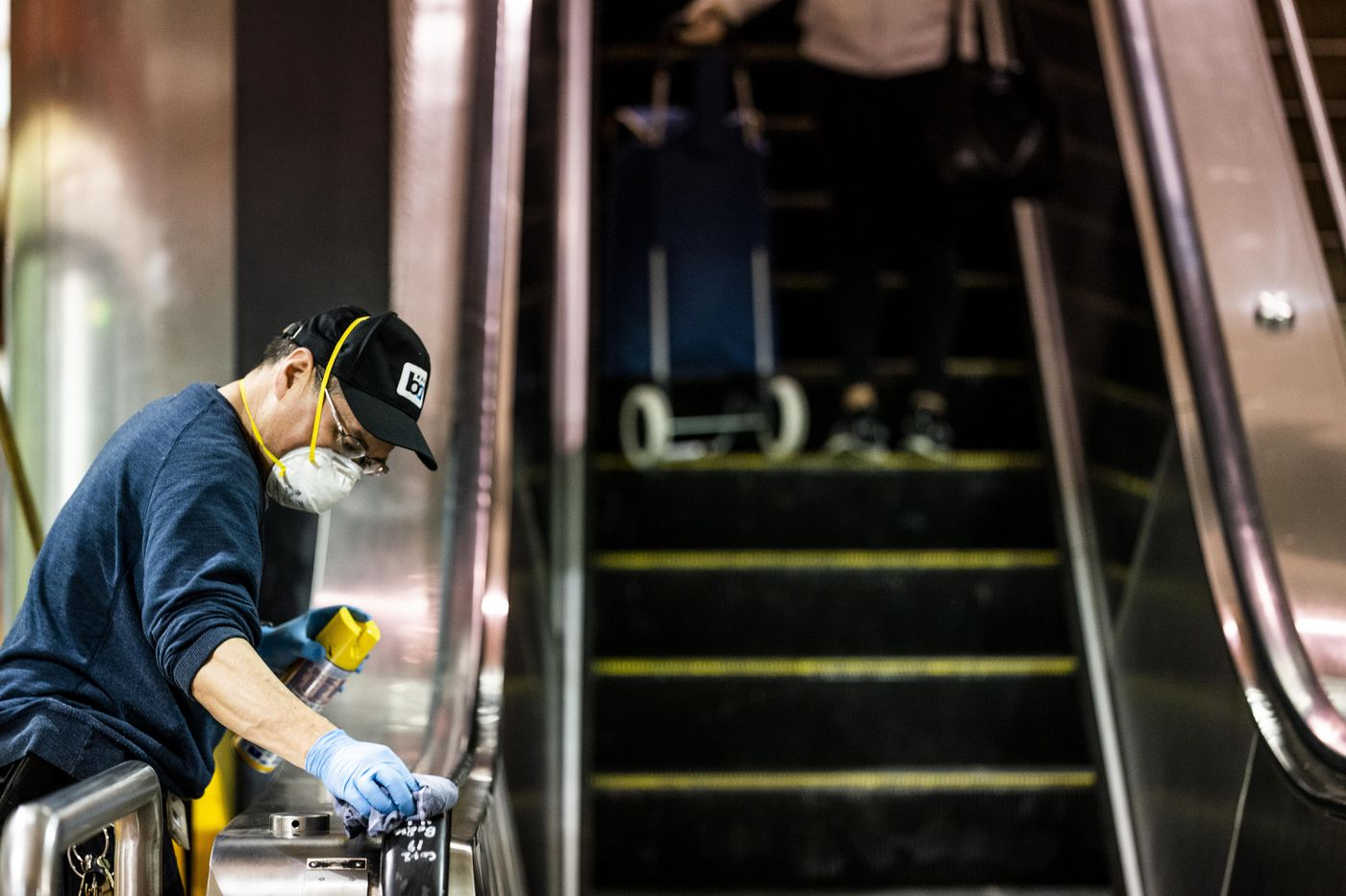 A worker disinfects an elevator as part of the BART system in San Francisco. Washington Post photo by Melina Mara