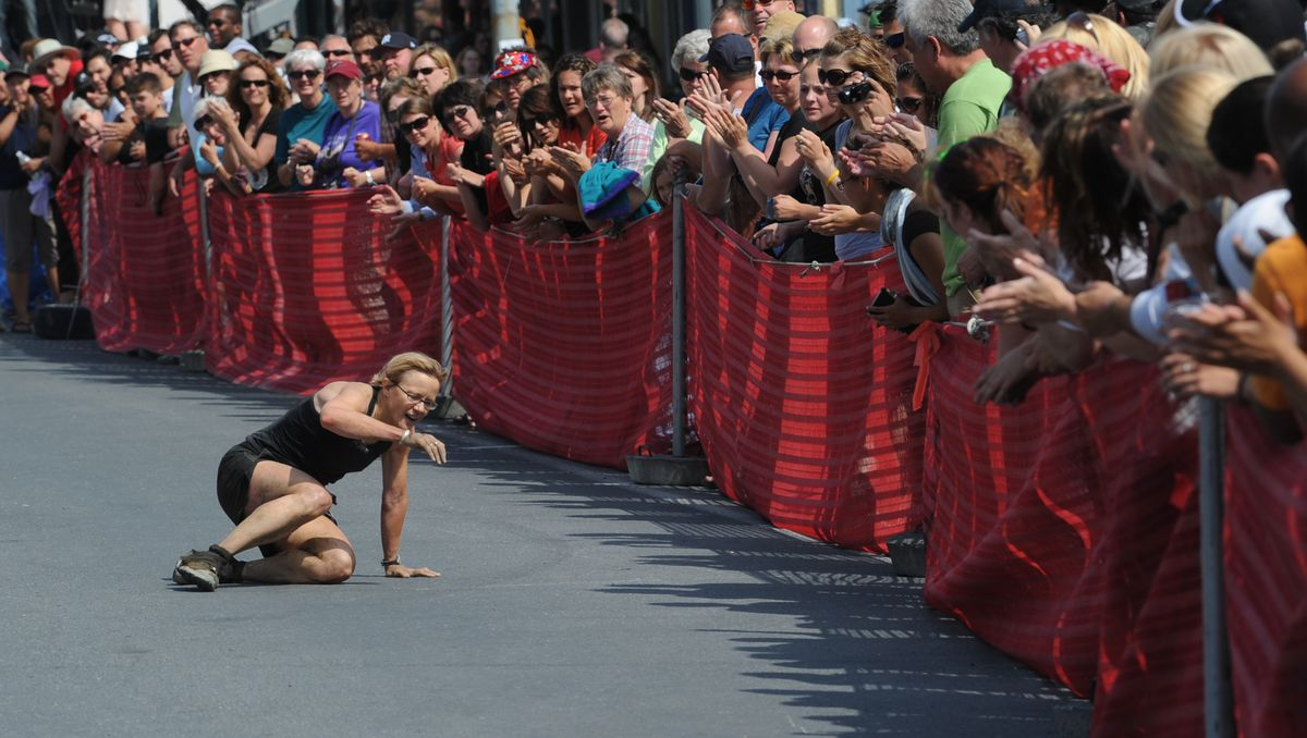 Cramps and the effects of heat took down runner Karen Williamsnear the finish line of the 2009 Mount Marathon race. Another hot day is expected Wednesday. (Erik Hill / ADN archive)