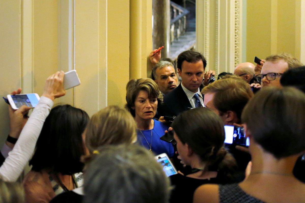 Sen. Lisa Murkowski speaks with reporters about health care legislation outside the Senate floor at the U.S. Capitol in Washington on July 18. (Jonathan Ernst / Reuters)