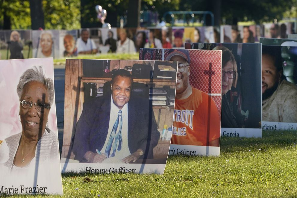 In this Aug. 31, 2020, photo, some of the nearly 900 large poster-sized photos of Detroit victims of COVID-19 are displayed on Belle Isle in Detroit. (AP Photo/Carlos Osorio, File)
